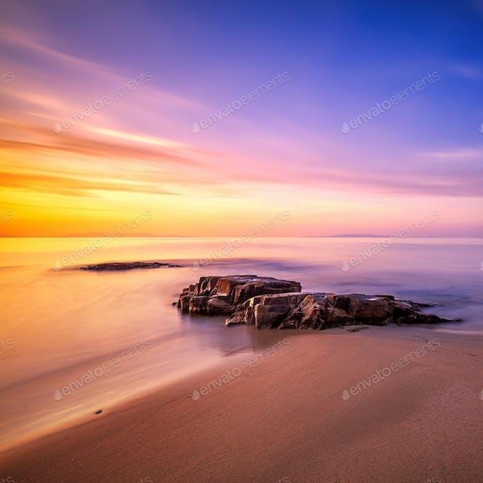 Rocks in Cala Violina beach in Maremma on sunset, Tuscany. Medit