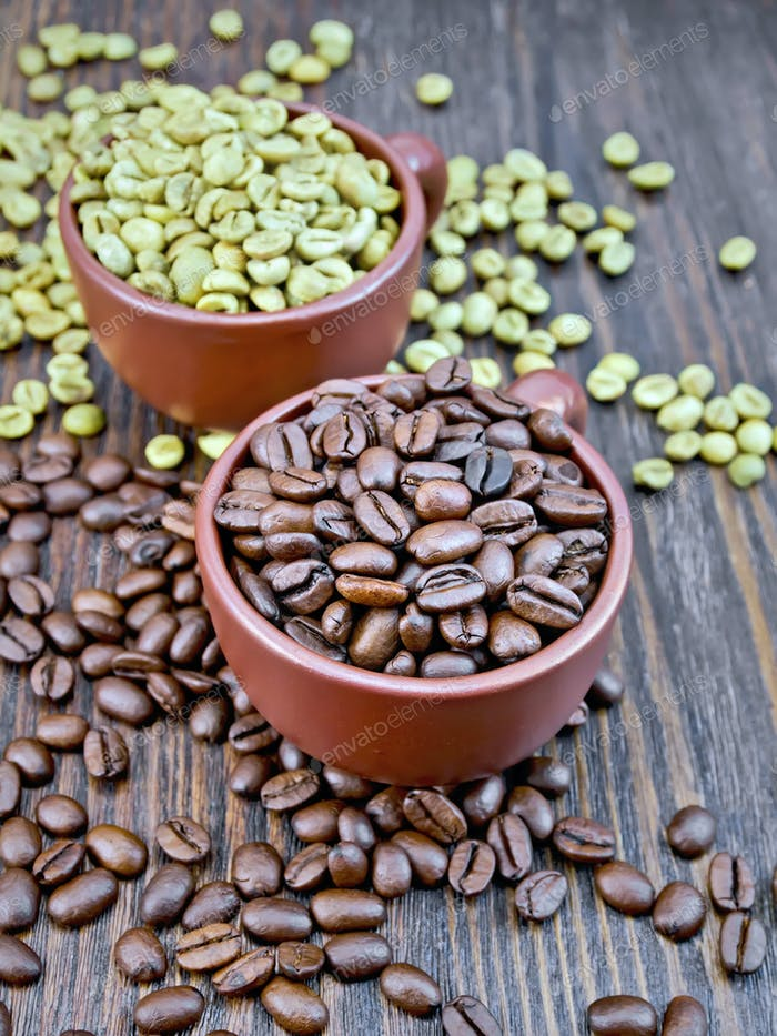 Coffee black and green grains in cups on board