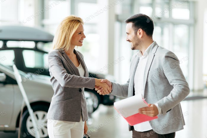 Customer buying a car at dealership
