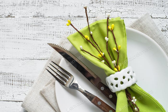 Spring Table setting at white wooden table.