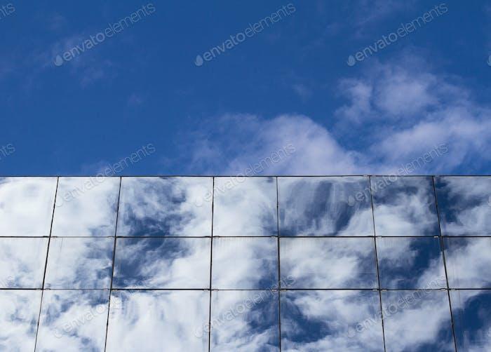 Clouds reflected in skyscraper windows