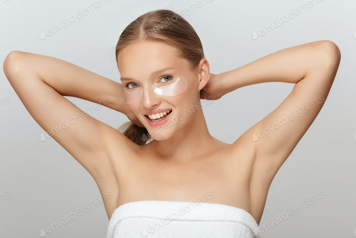 Portrait of young joyful woman without makeup with transparent p