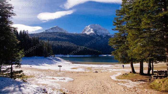 winter mountains and snow lake