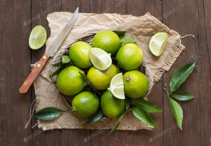 Fresh limes with knife