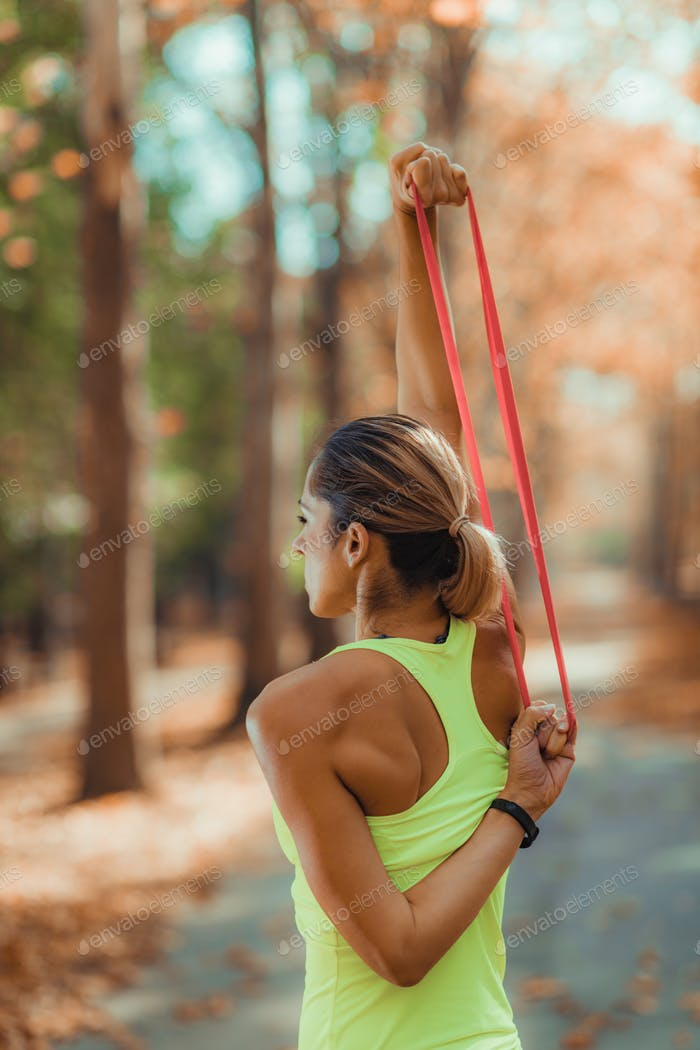 Woman Exercising with Resistance Band Outdoors