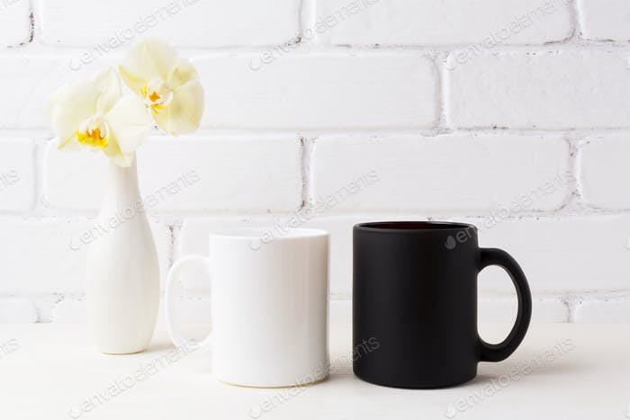 White and black mug mockup with soft yellow orchid in vase