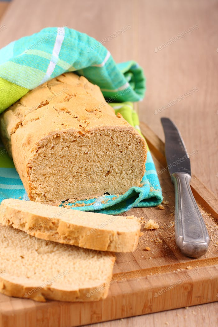 Fresh from the oven gluten free bread on a cutting board