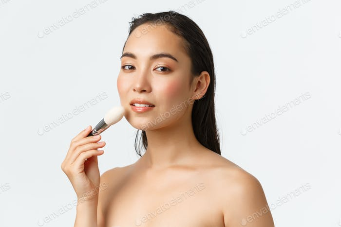 Skincare, women beauty, hygiene and personal care concept. Sensual beautiful asian woman standing