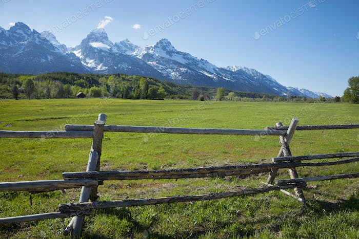 Old Wood Rail Fence in Field Below Grand Teton Mountains