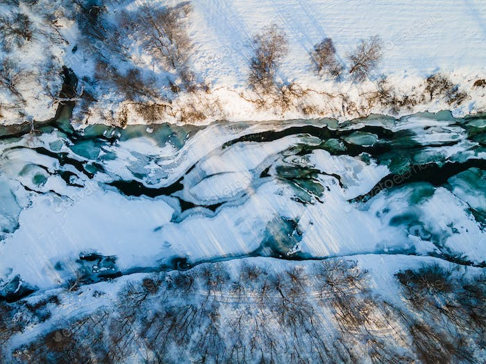 Abstract Top Down Drone View on Frozen Ice COvered River