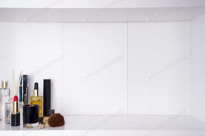 cosmetics in bathroom on a white bathroom shelf