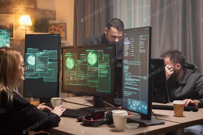 Female hacker with her team of cyber terrorists