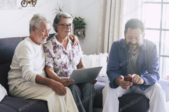 Caucasian family at home using modern technology