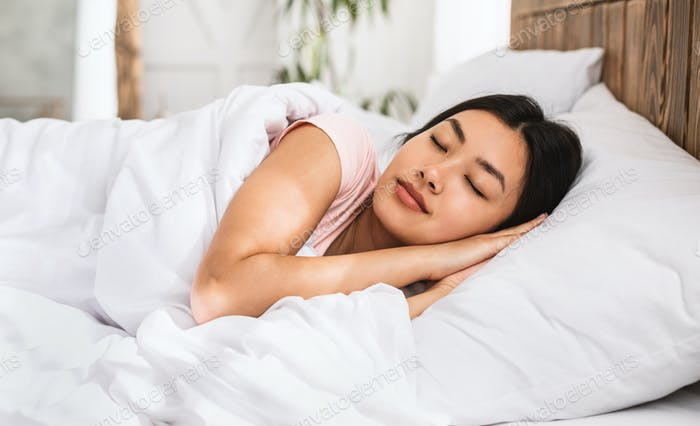 Asian Girl Sleeping Well Lying In Bed Resting At Home