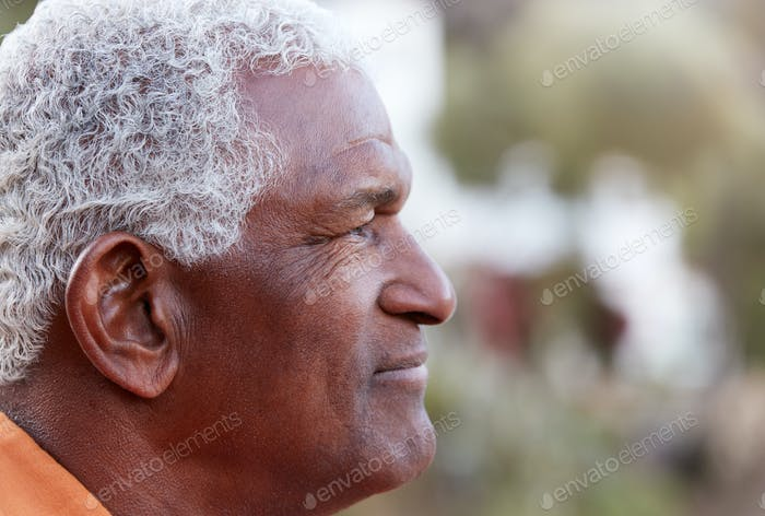 Outdoor Profile Portrait Of Serious African American Senior Man With Mental Health Concerns