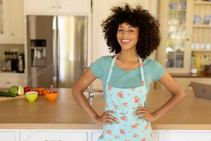 Young woman wearing apron in the kitchen