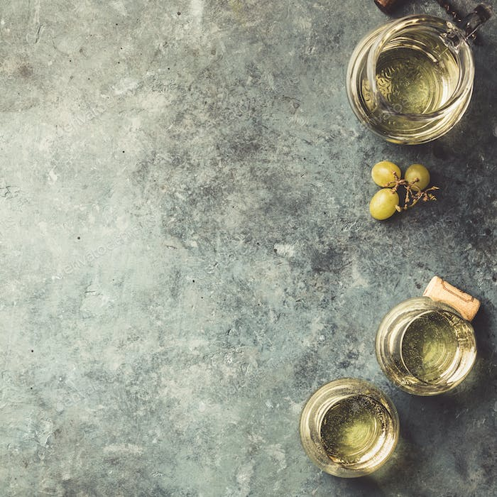 Glasses of white sparkling wine on rustick background