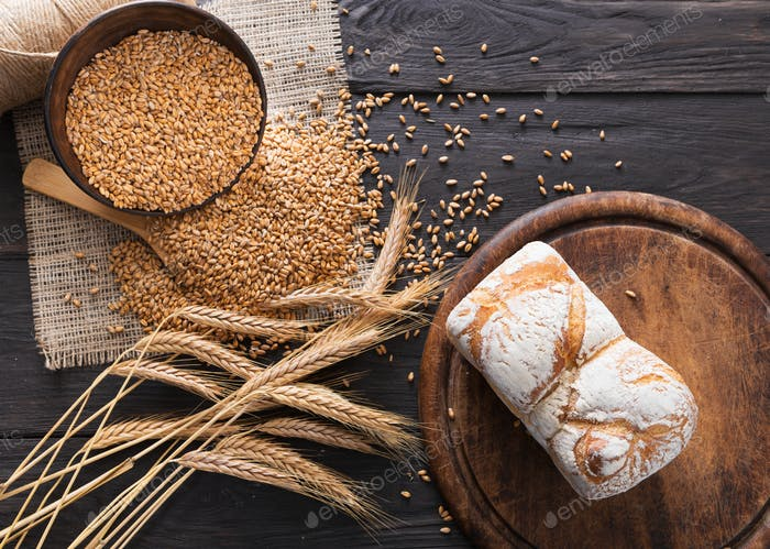 Bread bakery background. Whole grain loaves composition