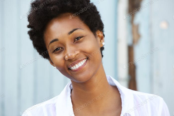 Happy young african woman with beautiful smile