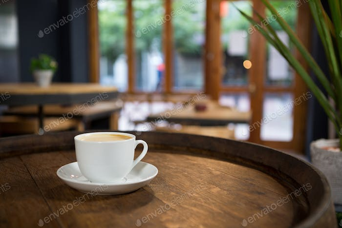 Cup of coffee on table at cafeteria