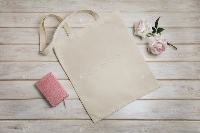 Placeit – Tote bag mockup with pink roses and notepad