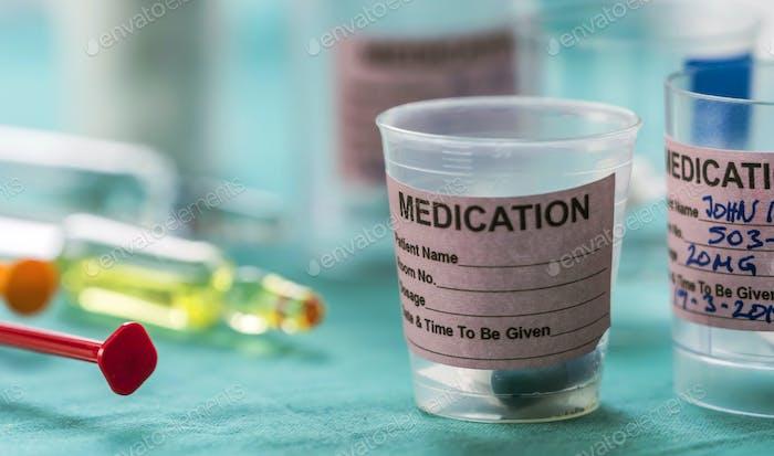 Diverse medication in glasses monodose