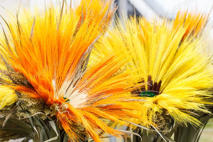Flowers made of ears of wheat or rye, concept of seasonal decoration