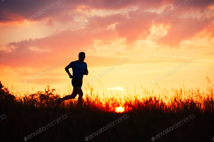 Athletic runner at the sunset