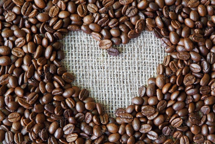 Coffee beans background with burlap heart frame