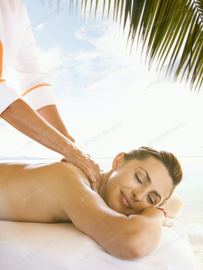 Caucasian woman enjoying massage