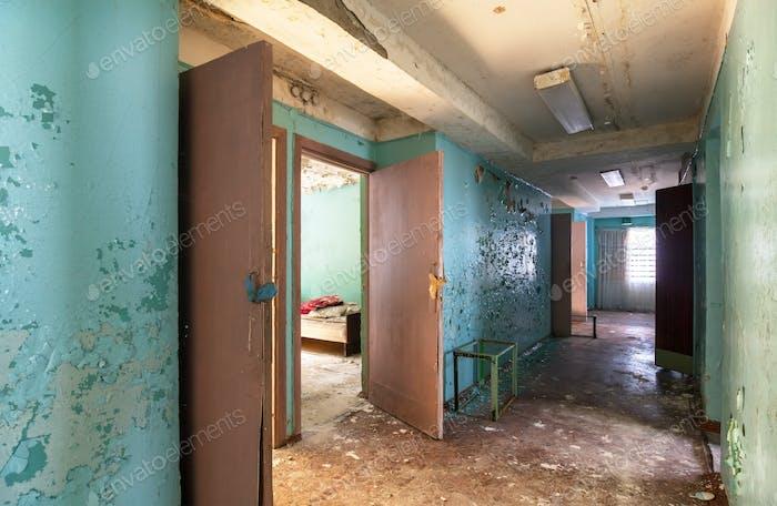 Corridor with open doors in an abandoned building