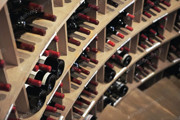 Downstairs and wine bottles in a winery