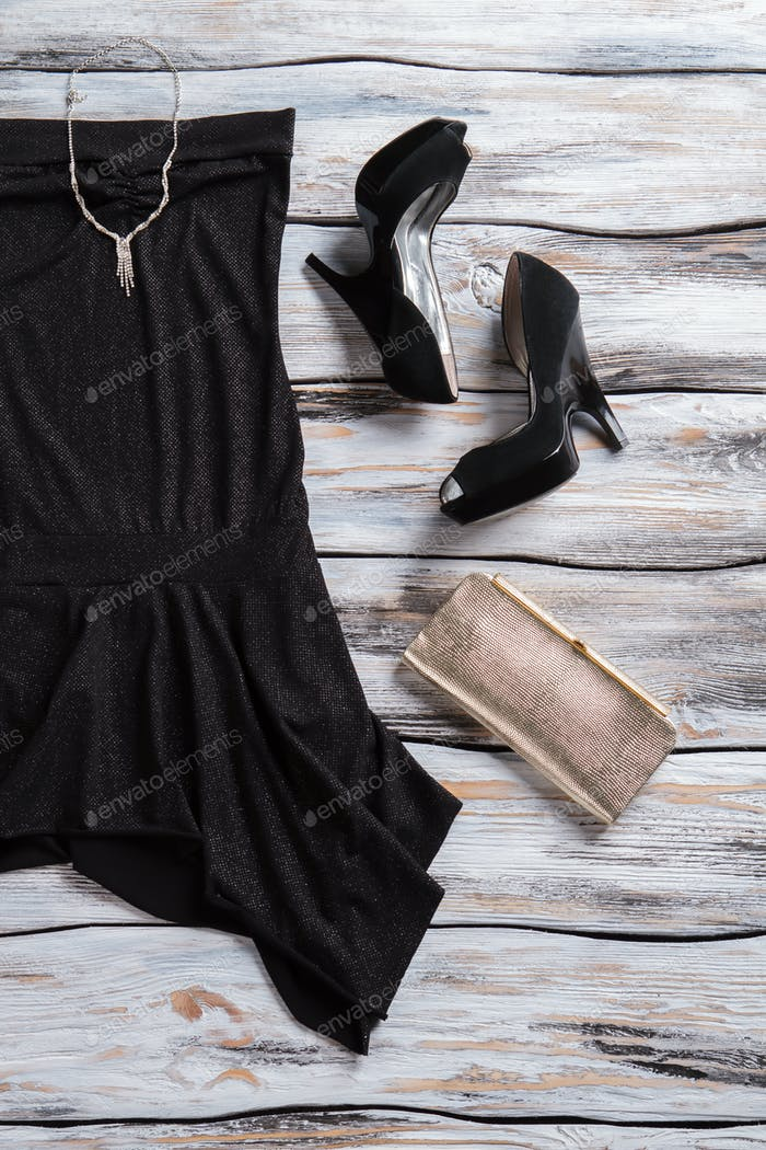 Black dress and silver purse.