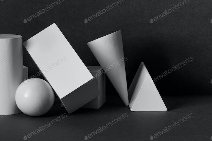 White geometric shapes on a black background.