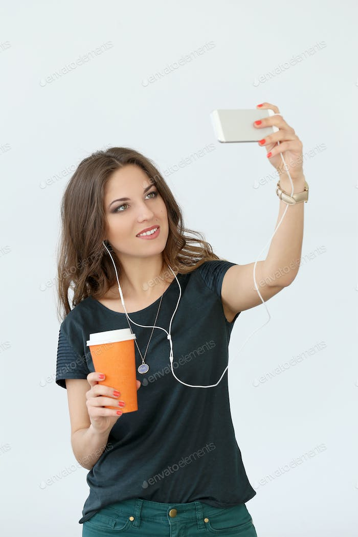 Curly girl with mobile phone