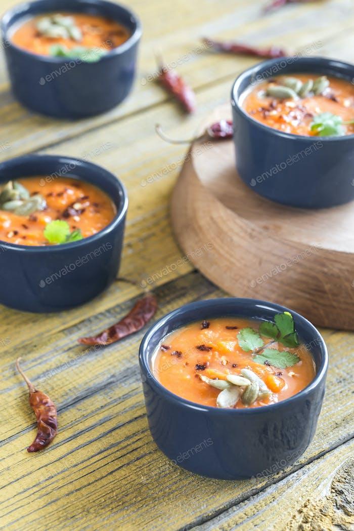 Bowls of pumpkin cream soup