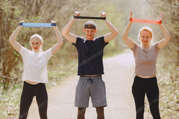 Sports family training in a summer forest