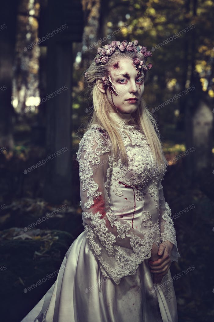 Dressed in wedding clothes romantic zombie woman.