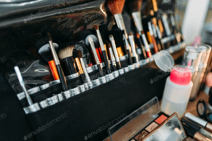 Collection of cosmetology tools on wooden table