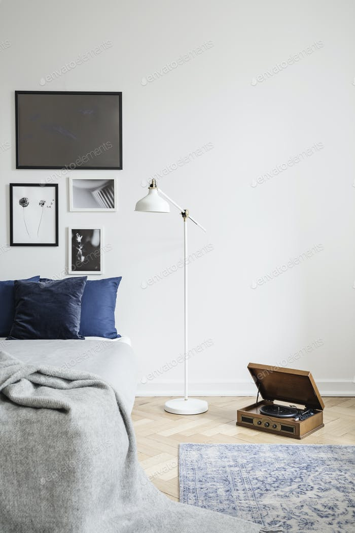 Retro vinyl record player and an industrial style floor lamp in