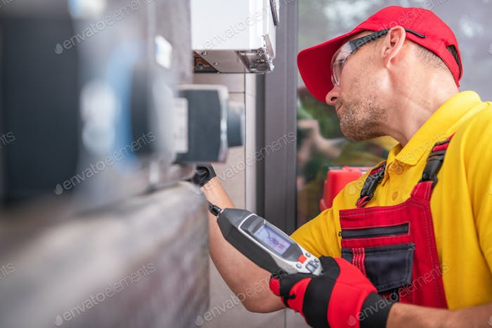 Technician with Gas Leak Detector Performing Scheduled Check