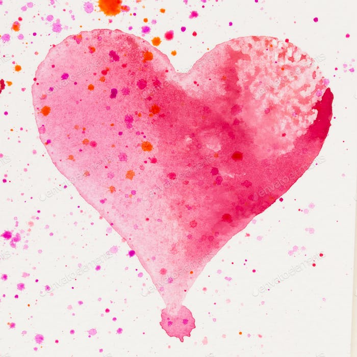 Watercolor painted pink heart, on the white watercolor paper.