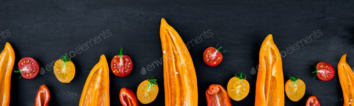 Banner of Mixed of half red and yellow pepper with a green branch near cherry tomato