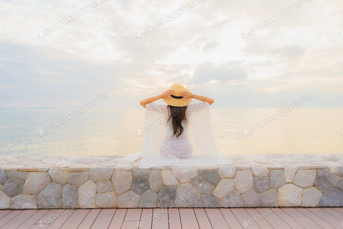 Portrait beautiful young asian women happy smile relax around sea beach ocean