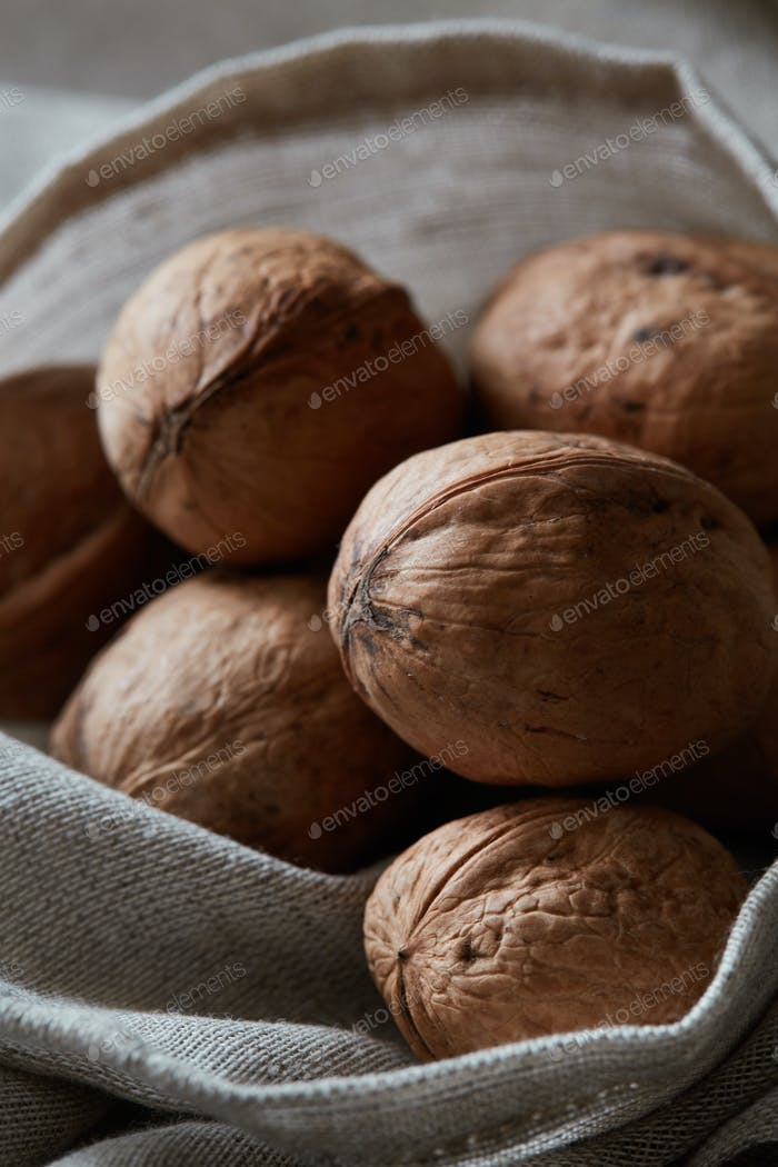 Walnuts on a rough fabric sack