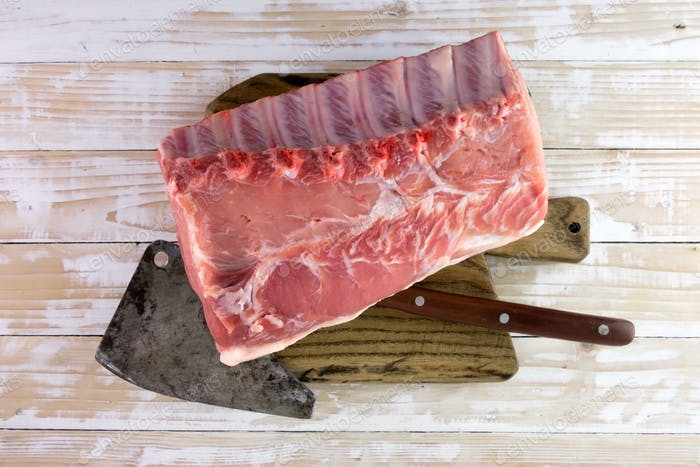 Fresh raw pork piece on wooden board
