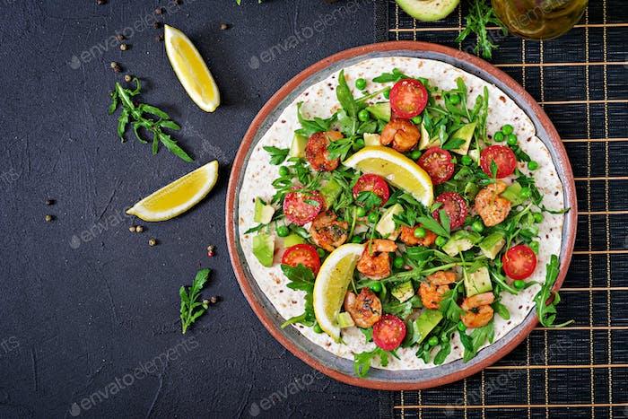 Shrimps tortilla tacos open face wrap with fresh vegetables