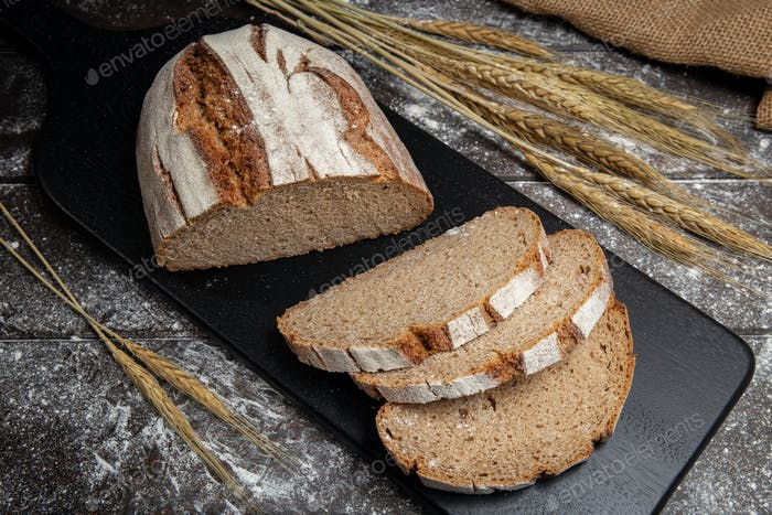 Baked rye bread on wooden table