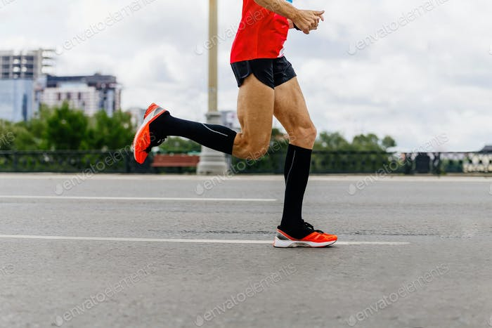runner in black compression socks