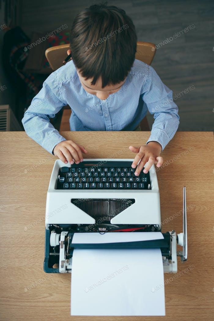 Boy with typewriter